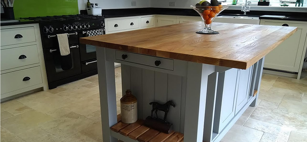 Freestanding kitchen island hand-painted in Farrow & Ball Manor House Gray