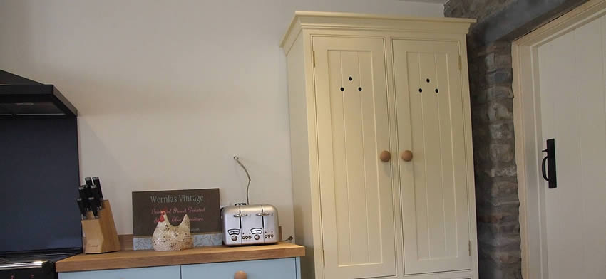 Painted tongue & groove freestanding larder cupboard with wicker baskets