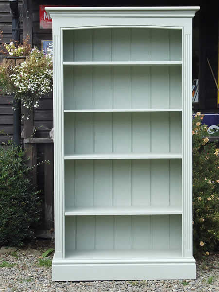 Freestanding bookcase finished in Farrow & Ball 'Blue Green'