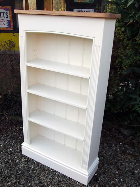 Freestanding bookcase with an oak cornice finished in Farrow & Ball 'Pointing'