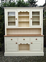 Large kitchen dresser finished in cream eggshell with half height glazed top doors