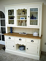 Large kitchen dresser with an oiled oak worktop & a half height glazed door top