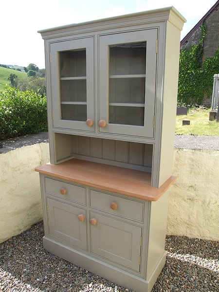 Small glazed kitchen dresser painted in Dulux Gardenia & fitted with oak knobs
