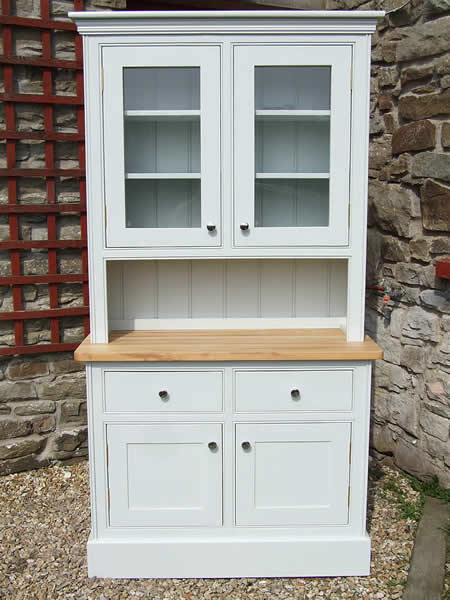 Small glazed kitchen dresser fitted with chrome door knobs