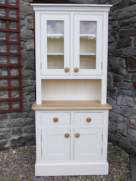 Small glazed kitchen dresser painted in Dulux Tallow fitted with an oiled oak worktop