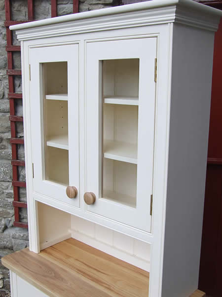 Small glazed kitchen dresser painted in Dulux Tallow fitted with oak door knobs