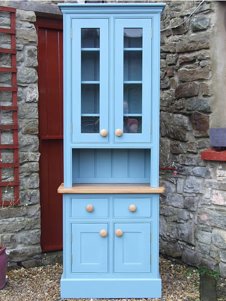 Small kitchen dresser with a glazed top fitted with an oiled oak worktop in Farrow & Ball Stone Blue
