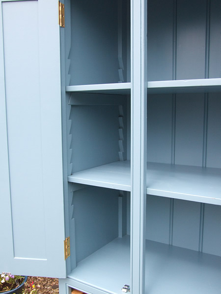 Narrow freestanding larder cupboard with adjustable shelves