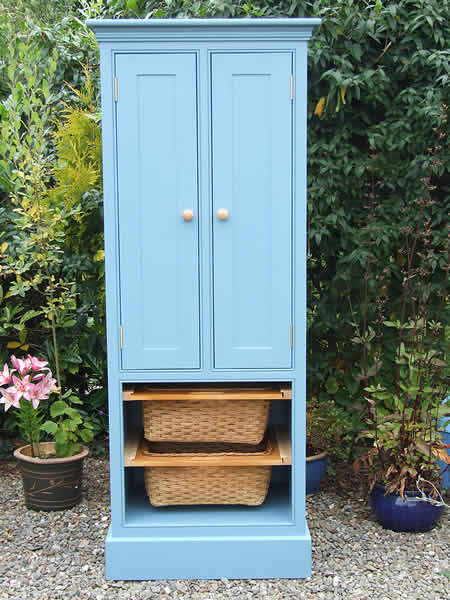 Narrow freestanding larder cupboard with two pull-out wicker baskets