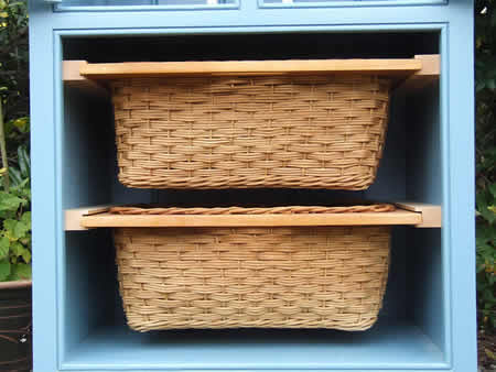 Small freestanding larder with two pull-out wicker baskets