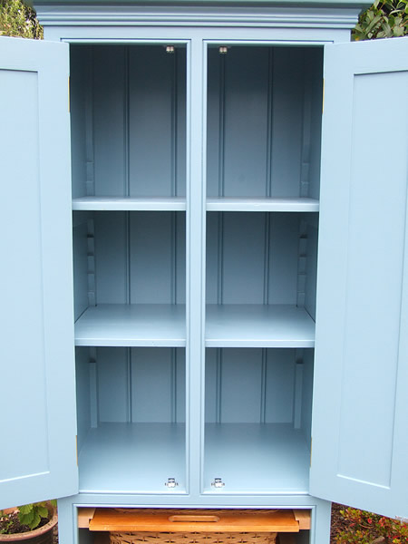 Narrow freestanding larder cupboard with open doors