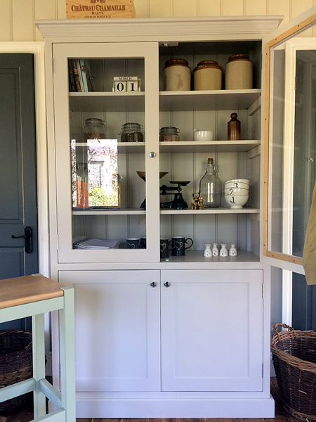 Freestanding larder cupboard with two glass door storage cupboard