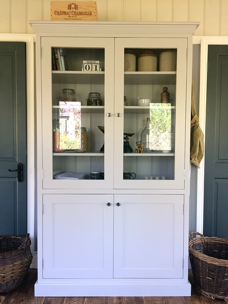 Freestanding larder cupboard with two glazed top doors