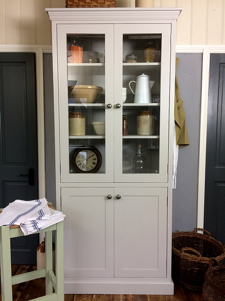 Freestanding larder cupboard with glazed top