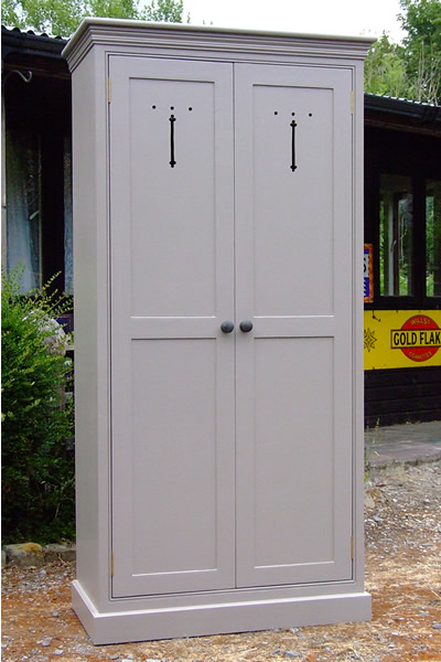 Freestanding larder cupboard in Farrow & Ball Charelston Gray with two full height doors