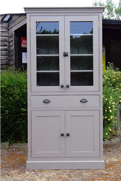 Freestanding larder cupboard with glazed door top, solid panelled door base storage & full width drawer