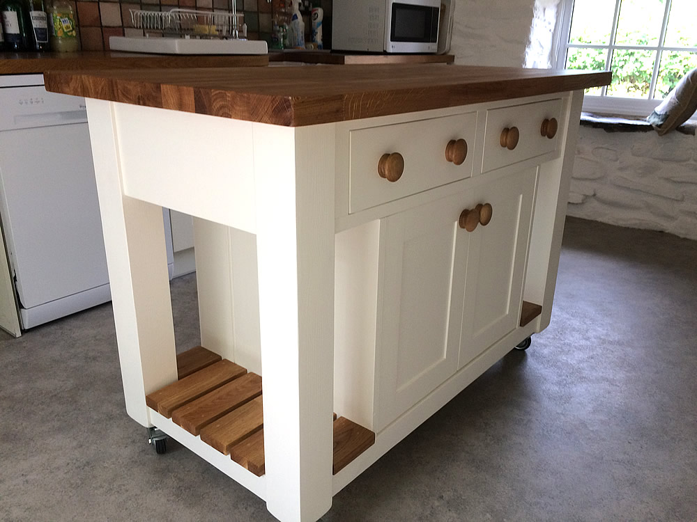 Freestanding Kitchen Island fitted with slatted oak end shelves