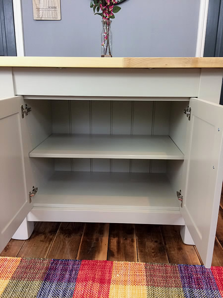 Freestanding kitchen island cupboard interior showing detail of the adjustable shelf