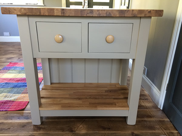 Freestanding kitchen island incorporating double deep wooden dovetailed drawers at both ends