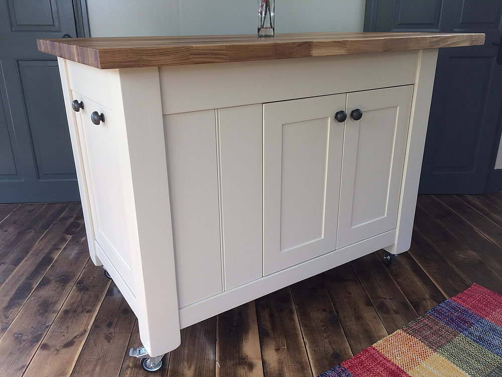 Freestanding kitchen island painted in Farrow & Ball 'Joa's White'