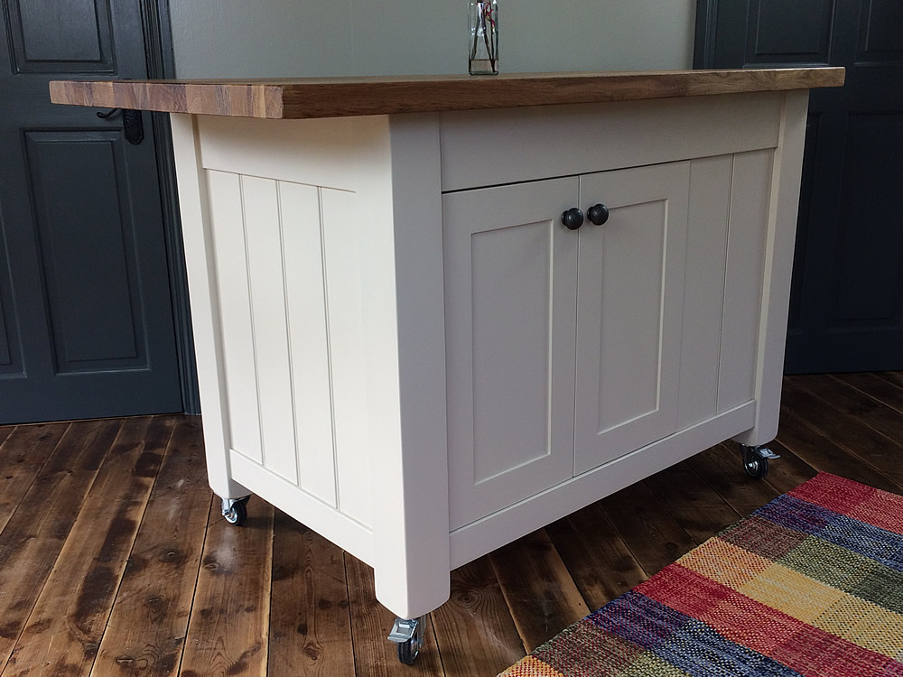 Freestanding kitchen island with small end breakfast bar