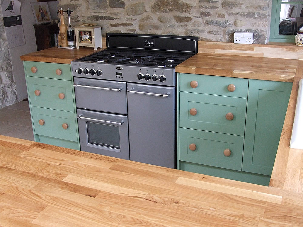 Painted Shaker kitchen with double matching 3 drawer pan cupboards in Farrow & Ball 'Breakfast Room Green'