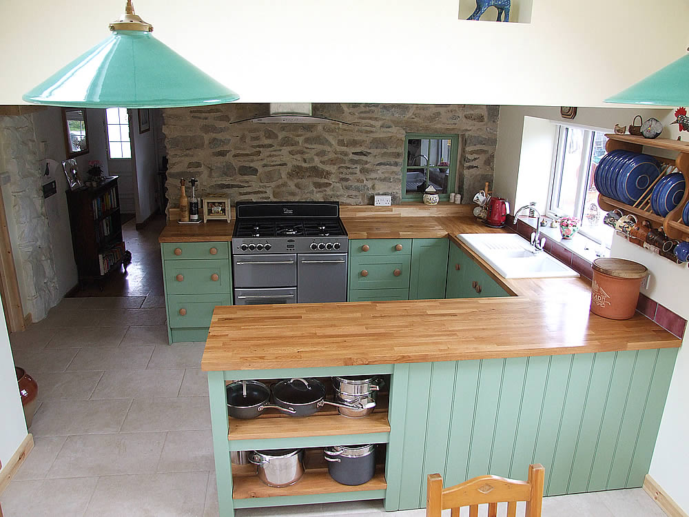 Painted Shaker kitchen with oak worktops finished in Farrow & Ball 'Breakfast Room Green'