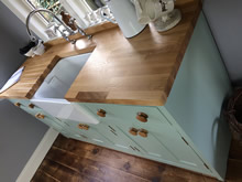 Freestanding belfast sink cabinet fitted with a wooden worktop