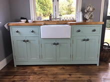 Freestanding belfast sink cabinet fitted with metal pewter knobs