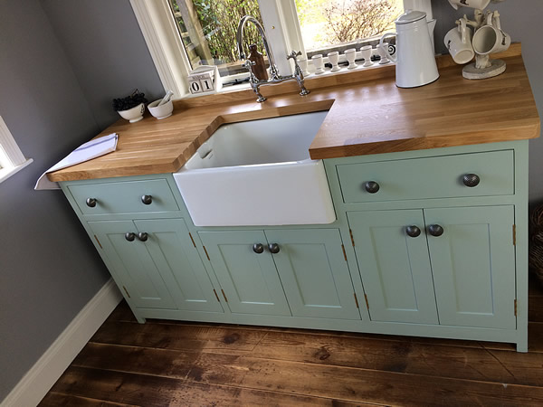 freestanding belfast sink cupboard fitted with an oak worktop
