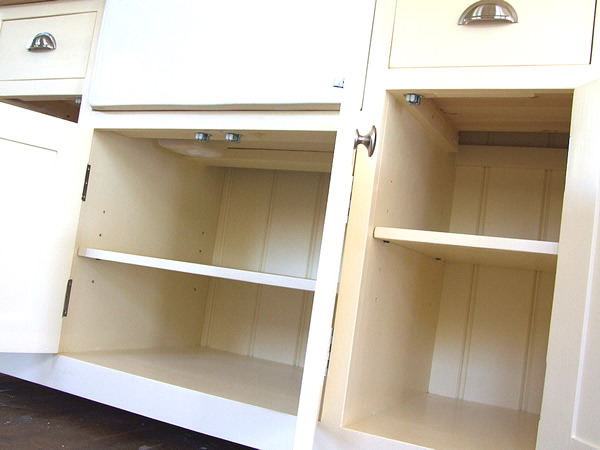 Freestanding Befast sink unit with fully adjustable shelves in each storage cupboard