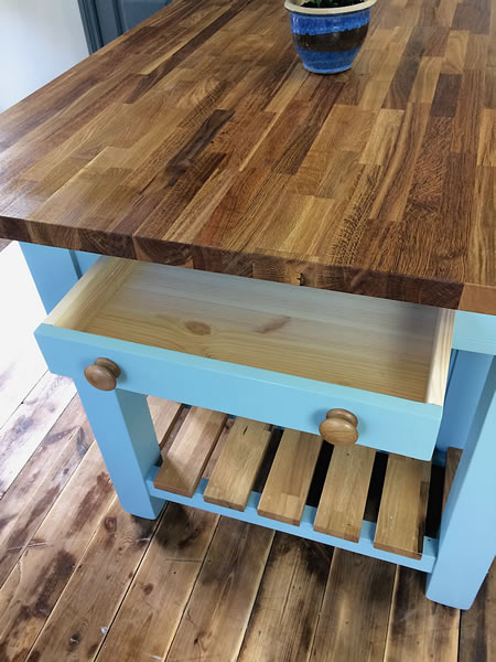 Medium freestanding kitchen island with a small cutlery drawer at one end