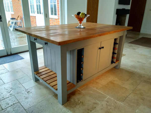 Large freestanding kitchen island with double slattted end shelves in Farrow & Ball Manor House Gray - in kitchen side view