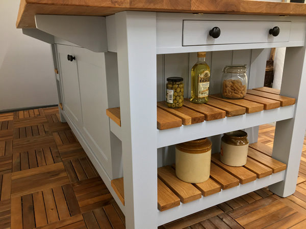 Large freestanding kitchen island with a long breakfast bar along on side