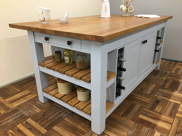 Large freestanding kitchen island with 40mm thick planked oak worktop and matching oak shelves