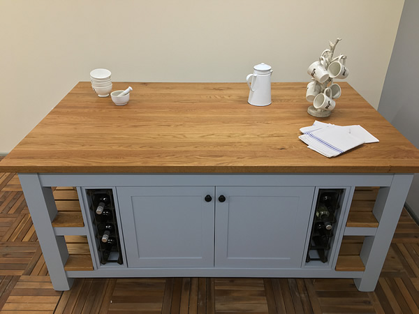 Large freestanding kitchen island fitted with solid timber planked oak worktop