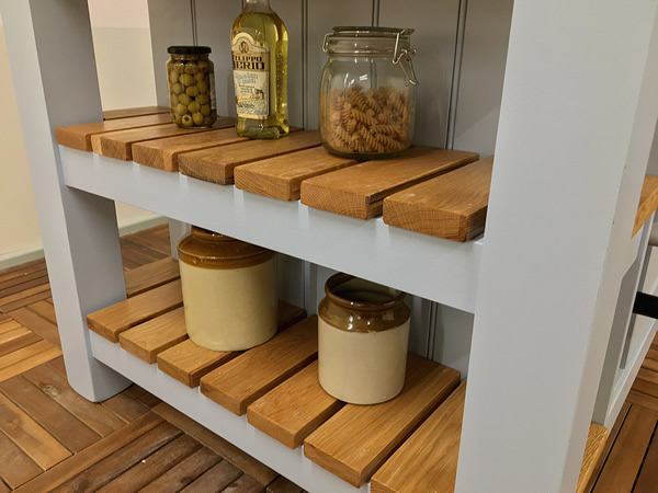 Large freestanding kitchen island with double slatted end display shelves