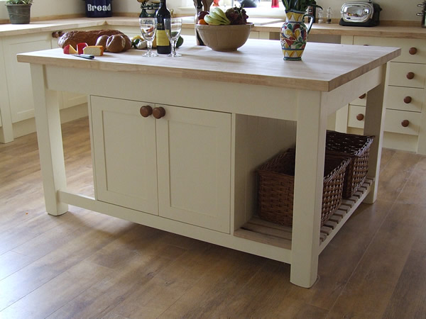 freestanding kitchen island with a breakfast bar & slatted end shelf