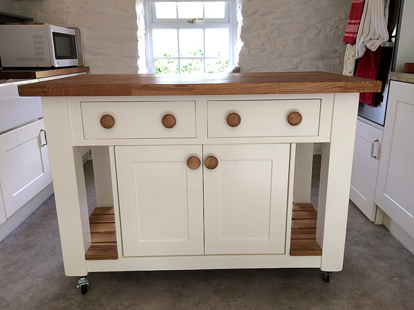 freestanding kitchen island with a double cupboard & side drawers