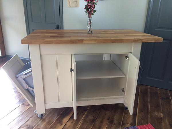 Freestanding kitchen island fitted with a four door double sided cupboard