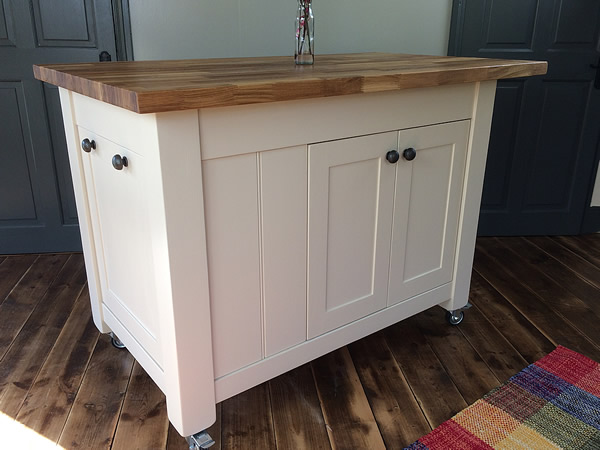 Freestanding kitchen island painted in Farrow & Ball 'Joa's White' eggshell