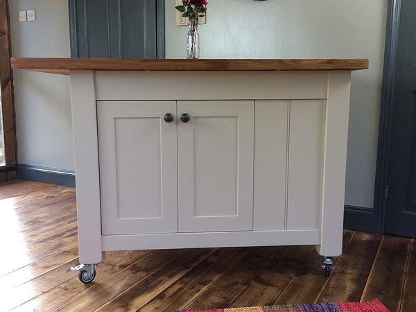 Freestanding kitchen island fitted with antiqued pewter knobs