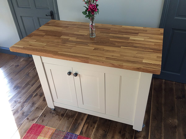 Freestanding kitchen island fitted with plain Shaker doors