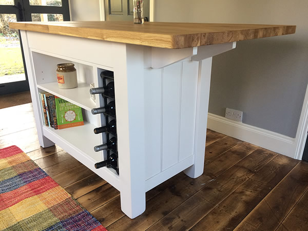 freestanding kitchen island with end overhanging breakfast bar seating area