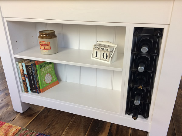 Freestanding kitchen island with a wine bottle rack & bookcase