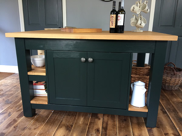 Large freestanding kitchen island with double door storage cupboard