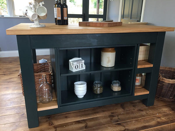 Large freestanding kitchen island with open shelf bookcase