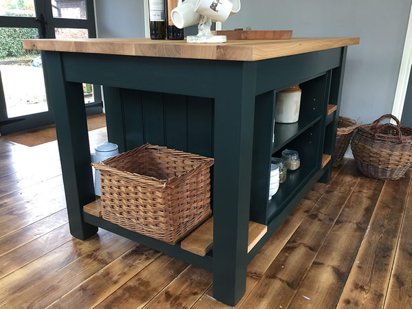 Freestanding kitchen island with oak slatted end shelf