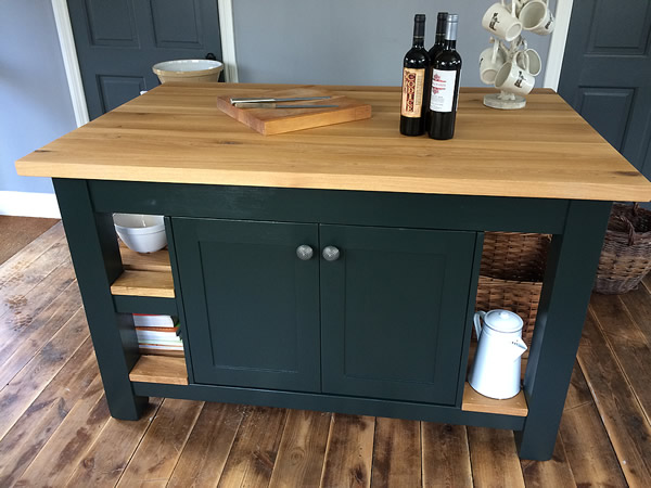 Large freestanding kitchen island fitted with a rustic oak wide board worktop.