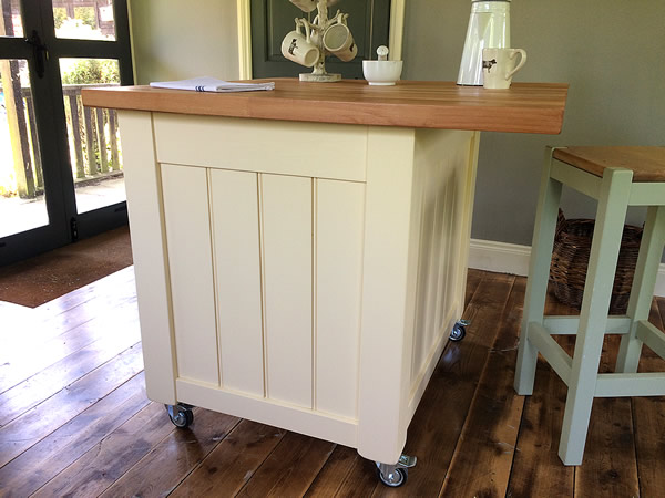 small freestanding kitchen island with a rear breakfast bar seating area